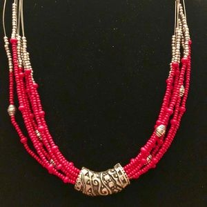 Red and silver beads on wire necklace